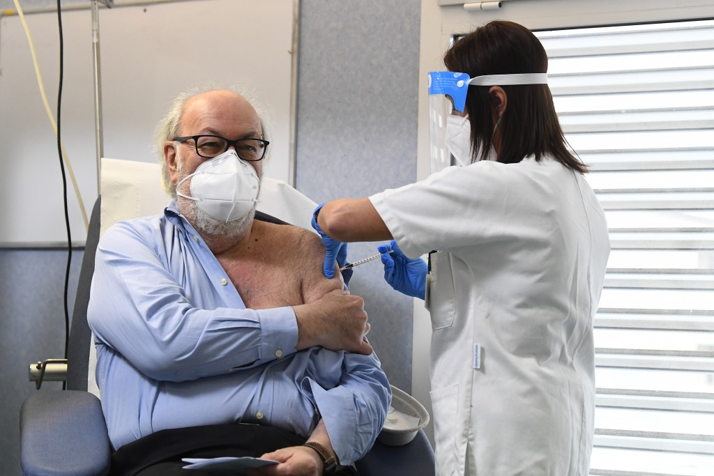 Dr. Massimo Vajani, 67, receives the Pfizer-BioNTech COVID-19 vaccine, at the Civico hospital, in Codogno, the northern Italian town that recorded Ita...