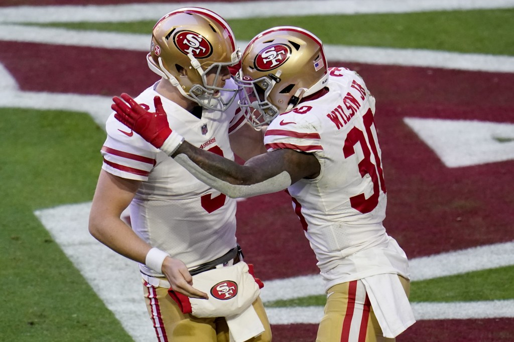 San Francisco 49ers running back Jeff Wilson (30) celebrates his touchdown against the Arizona Cardinals with quarterback C.J. Beathard (3) during the...