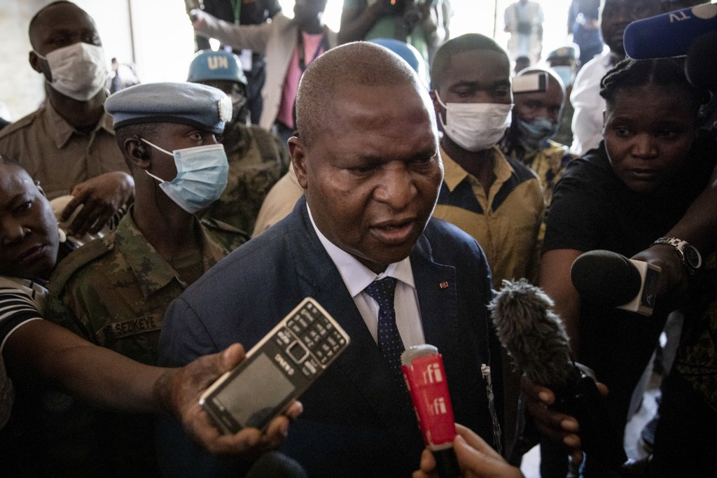 President Faustin-Archange Touadera speaks to the media after casting his vote at the Lycee Boganda polling station in the capital Bangui, Central Afr...
