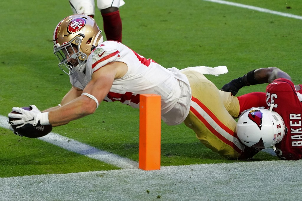 San Francisco 49ers fullback Kyle Juszczyk dives in for a touchdown as Arizona Cardinals strong safety Budda Baker (32) defends during the second half...