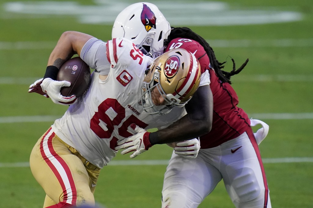 San Francisco 49ers tight end George Kittle (85) is hit by Arizona Cardinals center Lamont Gaillard (53) during the second half of an NFL football gam...
