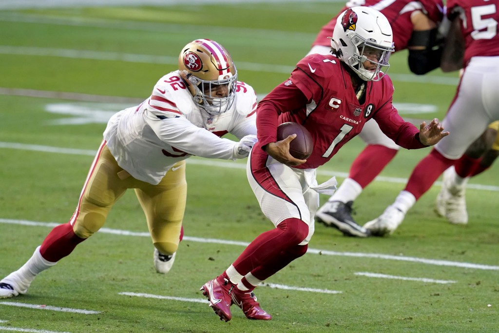 Arizona Cardinals quarterback Kyler Murray (1) eludes the reach of San Francisco 49ers defensive end Kerry Hyder (92) during the first half of an NFL ...