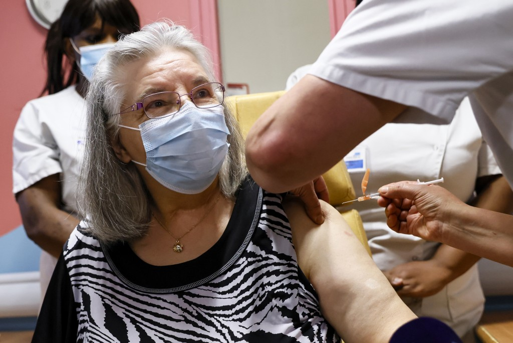 Mauricette, a French 78-year-old woman, is the first to get vaccinated for COVID-19 at the Rene-Muret hospital in Servan near Paris, Sunday Dec. 27, 2...