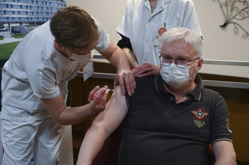 Professor of geriatrics Pierre Jouanny receives a dose of the Pfizer-BioNTech Covid-19 vaccine at the at the Champmaillot nursing home in Dijon, centr...