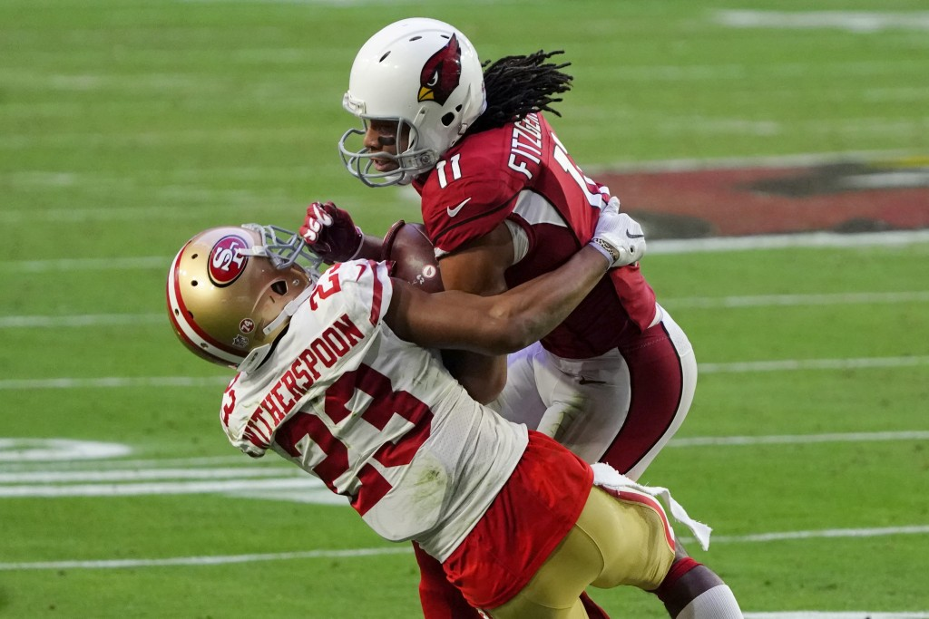 Arizona Cardinals wide receiver Larry Fitzgerald (11) makes a catch as San Francisco 49ers cornerback Ahkello Witherspoon (23) defends during the seco...