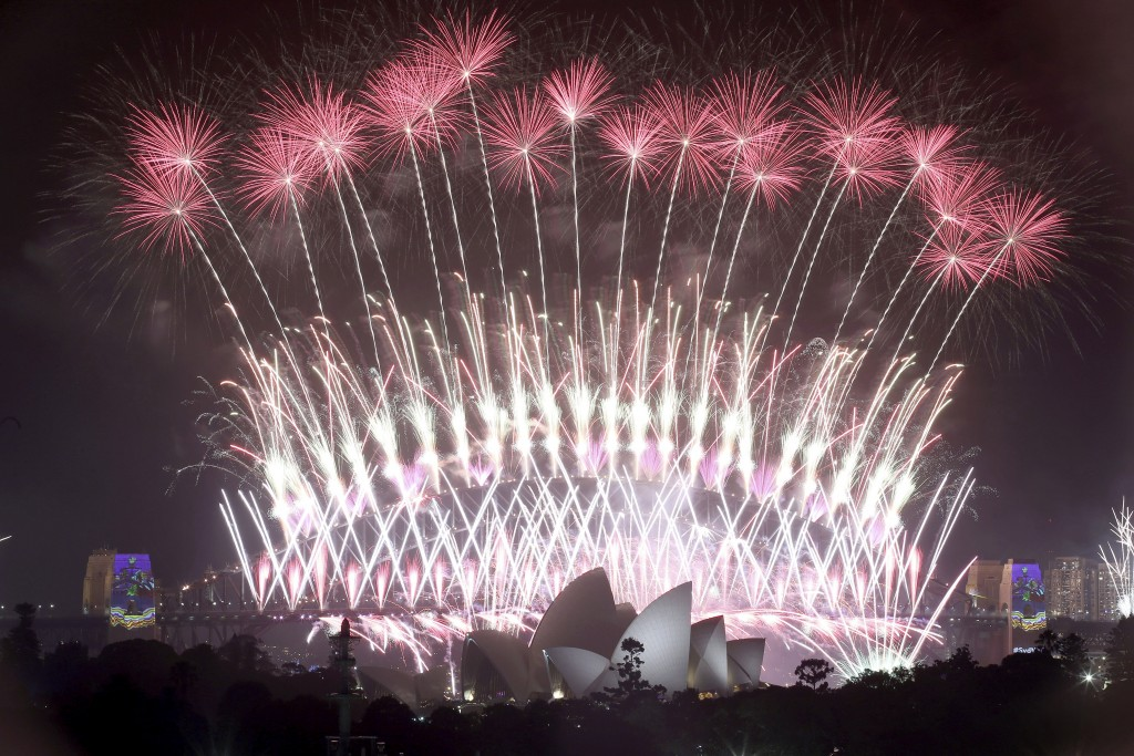 FILE - In this Jan. 1, 2017, file photo, fireworks explode over the Sydney Opera House and Harbour Bridge as New Year's celebrations are underway in S...