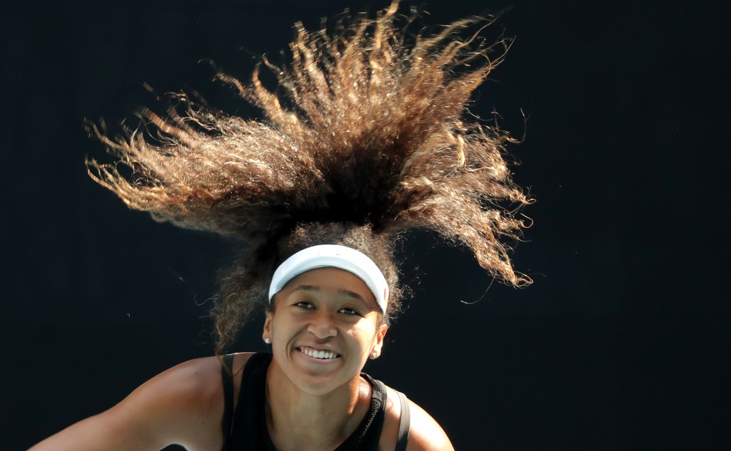 FILE - In this Jan. 18, 2020, file photo, Japan's Naomi Osaka serves during a practice session ahead of the Australian Open tennis tournament in Melbo...