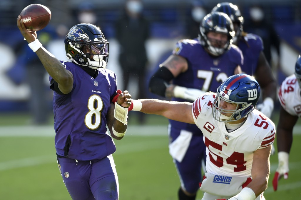 Baltimore Ravens quarterback Lamar Jackson (8) looks to throw a pass as New York Giants inside linebacker Blake Martinez (54) applies pressure during ...
