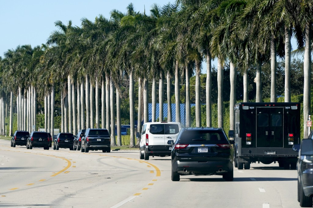 President Donald Trump's motorcade drives to Trump International Golf Club, Sunday, Dec. 27, 2020, in West Palm Beach, Fla. (AP Photo/Patrick Semansky...