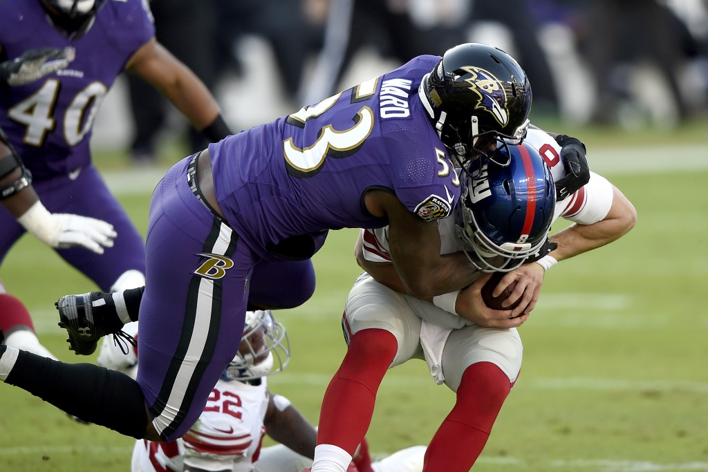 Baltimore Ravens defensive end Jihad Ward (53) sacks New York Giants quarterback Daniel Jones (8) during the second half of an NFL football game, Sund...