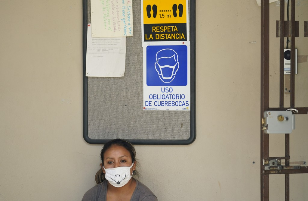 A woman seeking asylum in the United States and living at a camp in Matamoros, Mexico, waits for COVID-19 antibody test result at a clinic, Tuesday, N...