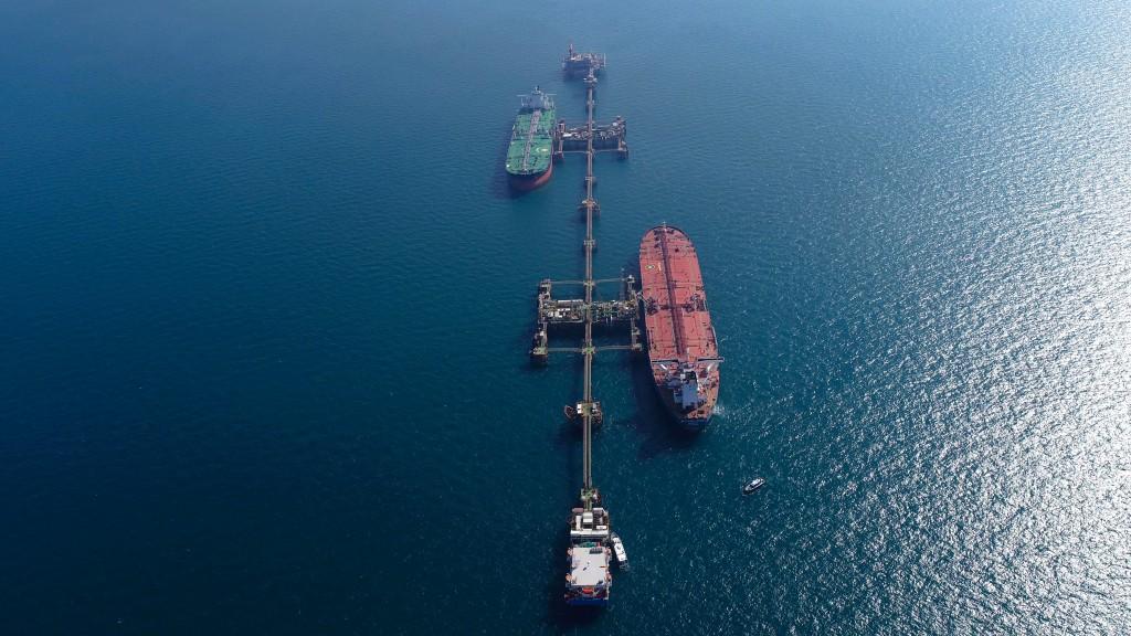 An aerial photo shows oil tankers load crude oil at Iraq's Al-Basra Offshore Terminal in Basra, Iraq, Sunday, Dec. 27, 2020. (AP Photo/Nabil al-Jurani...