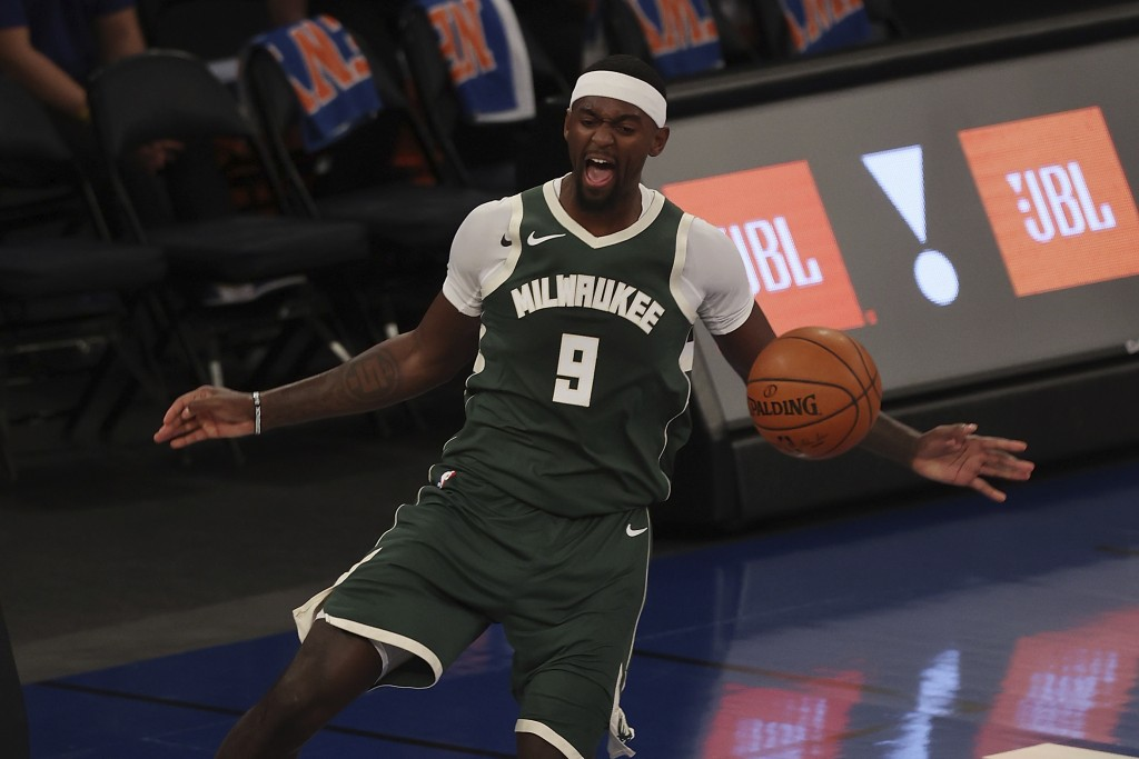 Bobby Portis of the Milwaukee Bucks reacts after dunking the ball against the New York Knicks at Madison Square Garden on Sunday, Dec. 27, 2020, in Ne...