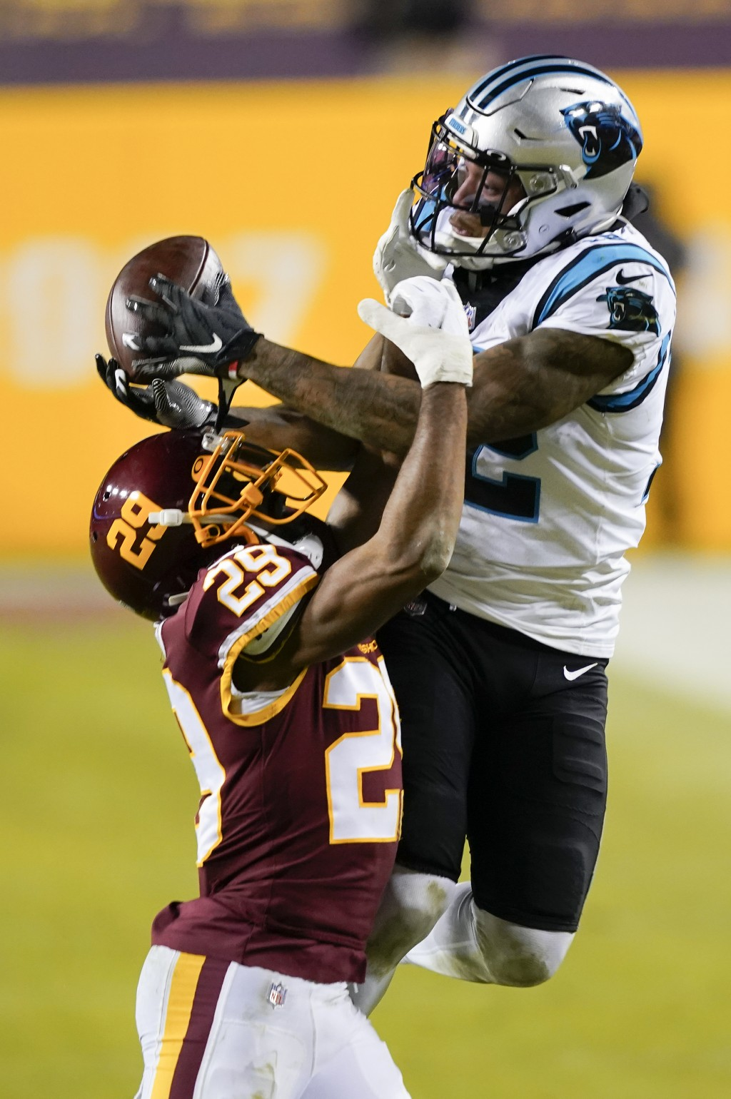 Washington Football Team cornerback Kendall Fuller (29) stops Carolina Panthers wide receiver D.J. Moore (12) from making a catch during the second ha...