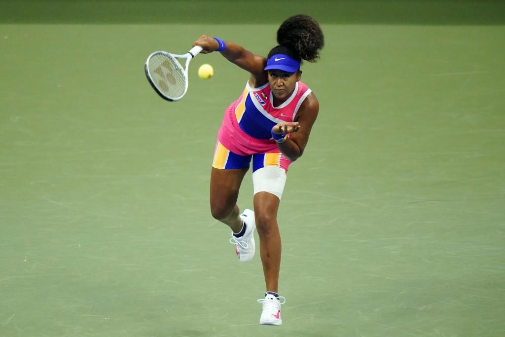 FILE - In this Sept. 6, 2020, file photo, Naomi Osaka, of Japan, serves to Anett Kontaveit, of Estonia, during the fourth round of the U.S. Open tenni...