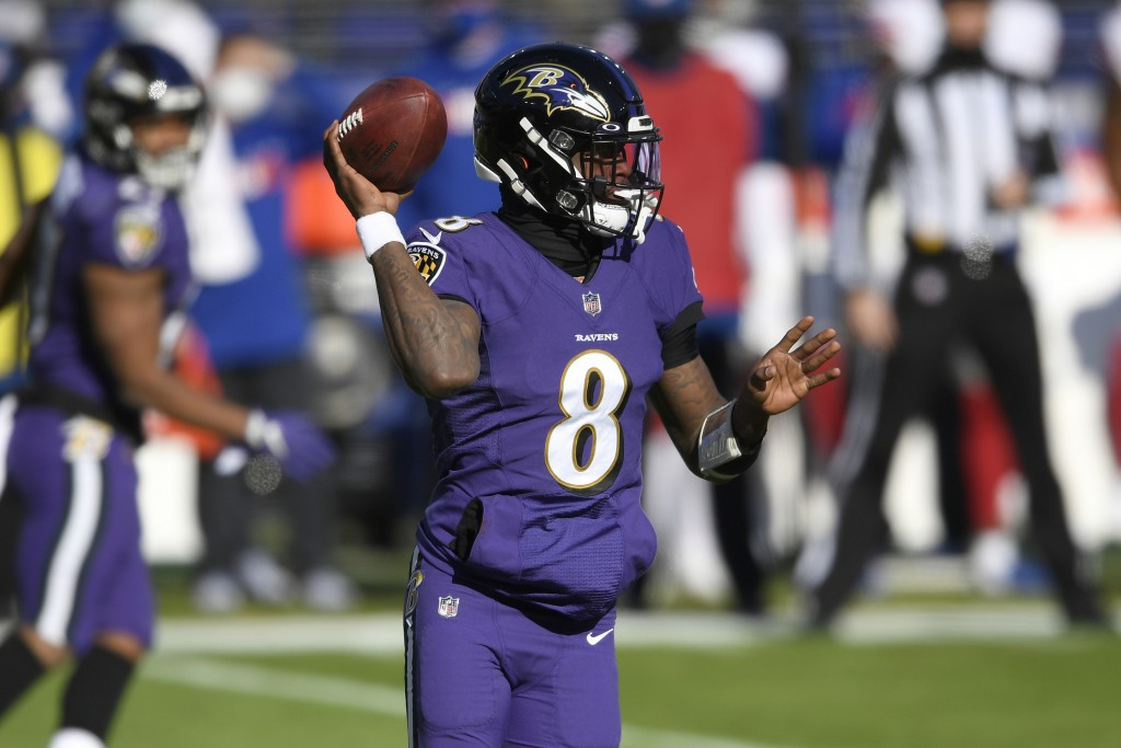 Baltimore Ravens quarterback Lamar Jackson looks to throw a pass against the New York Giants during the first half of an NFL football game, Sunday, De...