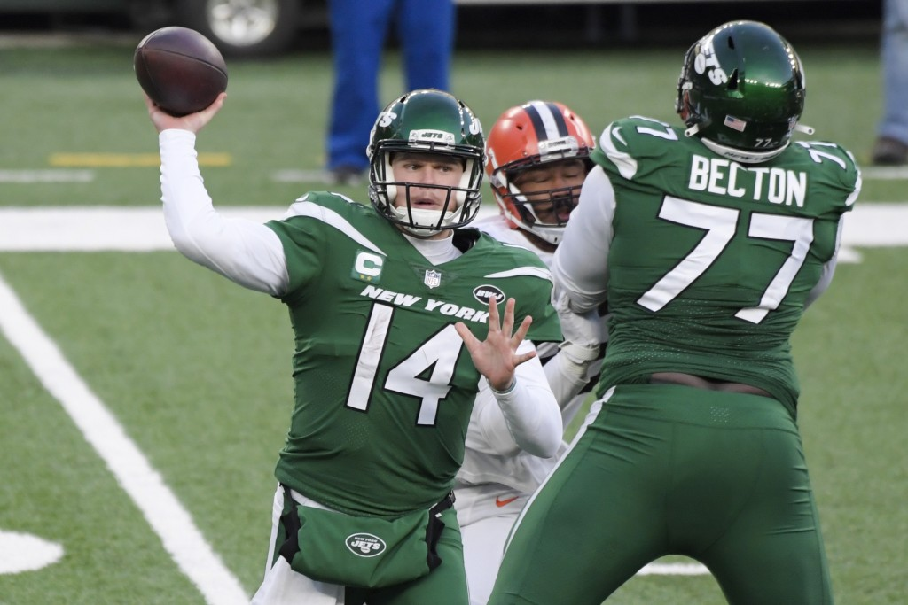 New York Jets quarterback Sam Darnold (14) throws a pass during the second half of an NFL football game as offensive tackle Mekhi Becton (77) blocks C...