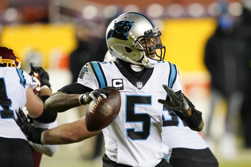 Carolina Panthers quarterback Teddy Bridgewater (5) passes the ball during the second half of an NFL football game against the Washington Football Tea...