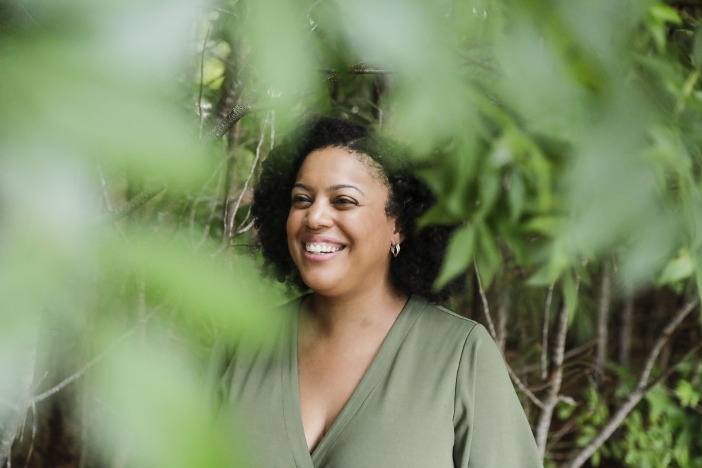 FILE - In this Friday, July 24, 2020 file photo, Charisse Davis, who serves on the Cobb County School Board, poses for a portrait in Marietta, Ga. On ...