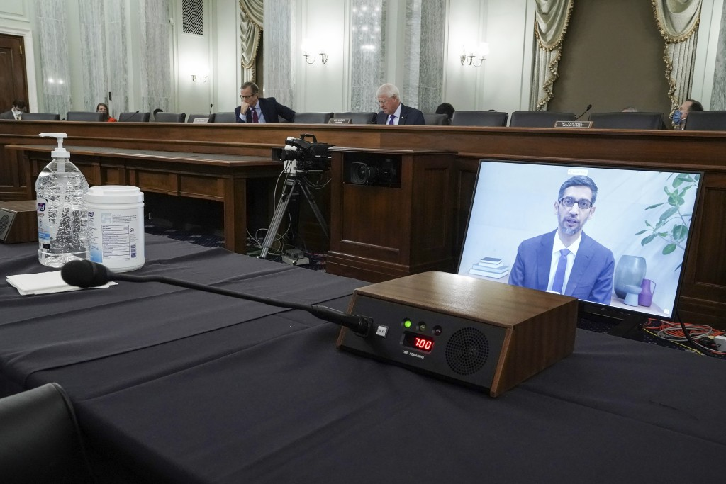 FILE - Google's CEO Sundar Pichais appears on a screen as he speaks remotely during a hearing before the Senate Commerce Committee on Capitol Hill, We...