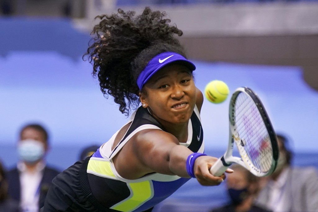 FILE - In this Sept. 12, 2020, file photo, Naomi Osaka, of Japan, returns a shot to Victoria Azarenka, of Belarus, during the women's singles final at...