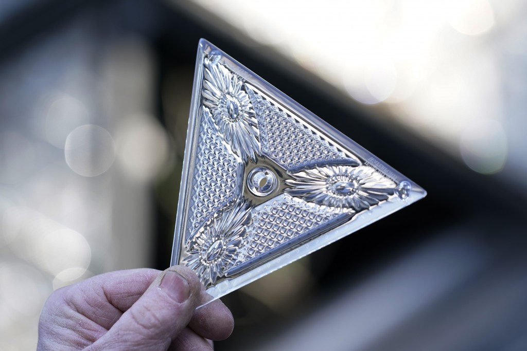 A worker holds one of the 192 Waterford crystal triangles that will be placed on the Times Square New Year's Eve ball, Sunday, Dec. 27, 2020, in New Y...