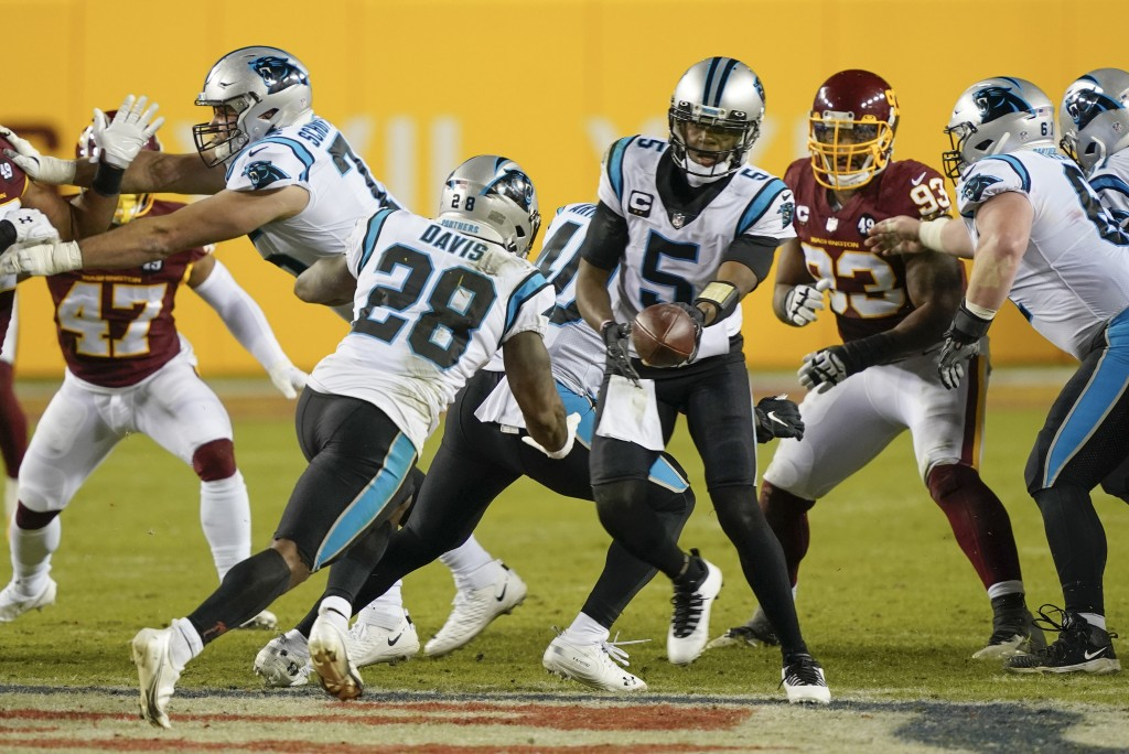 Carolina Panthers quarterback Teddy Bridgewater (5) hands the ball off to running back Mike Davis (28) during the second half of an NFL football game ...