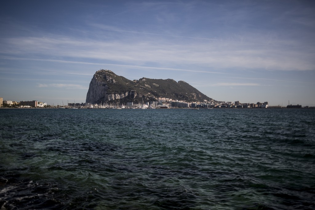 FILE - In this Thursday, Oct. 17, 2019 file photo, an eerial view of Gibraltar rock seen from the neighbouring Spanish city of La Linea, during a gene...