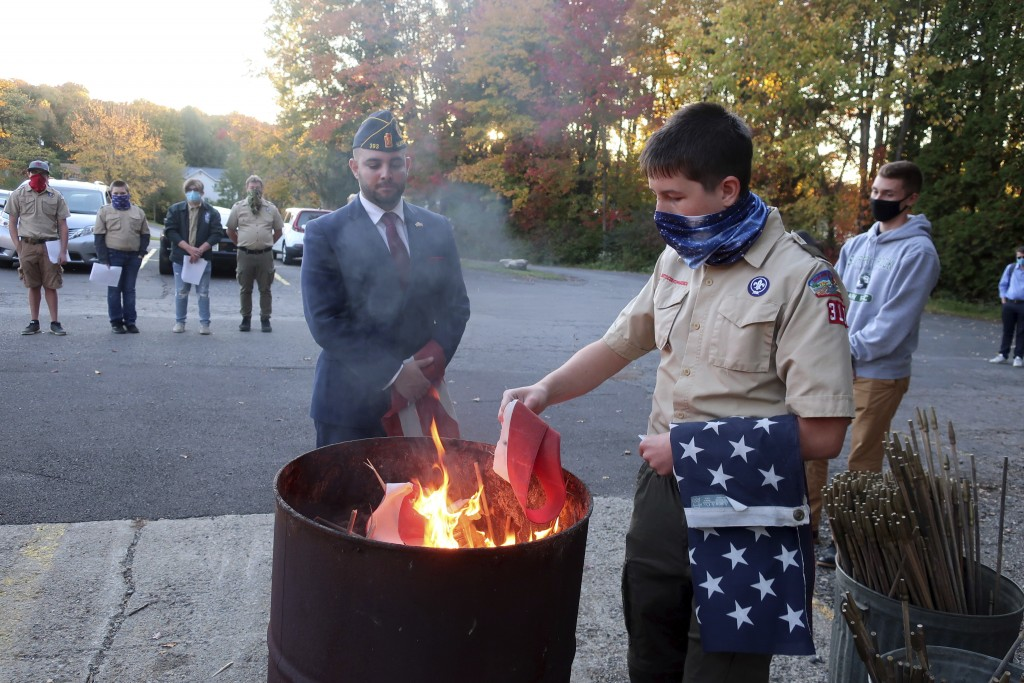 FILE - In this Tuesday, Oct. 13, 2020 file photo, Jondavid Longo, Republican mayor of Slippery Rock, Pa., center, presides over a Boy Scouts flag reti...