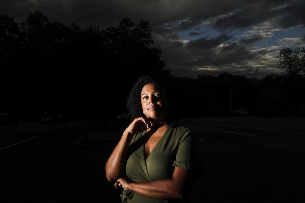 FILE - In this Friday, July 24, 2020 file photo, Charisse Davis poses for a portrait in Marietta, Ga. Davis, who serves on the school board in suburba...