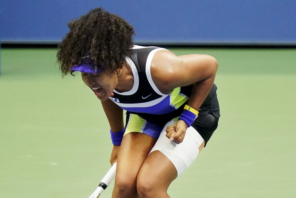 FILE - In this Sept. 12, 2020, file photo, Naomi Osaka, of Japan, reacts during the women's singles final against Victoria Azarenka, of Belarus, at th...