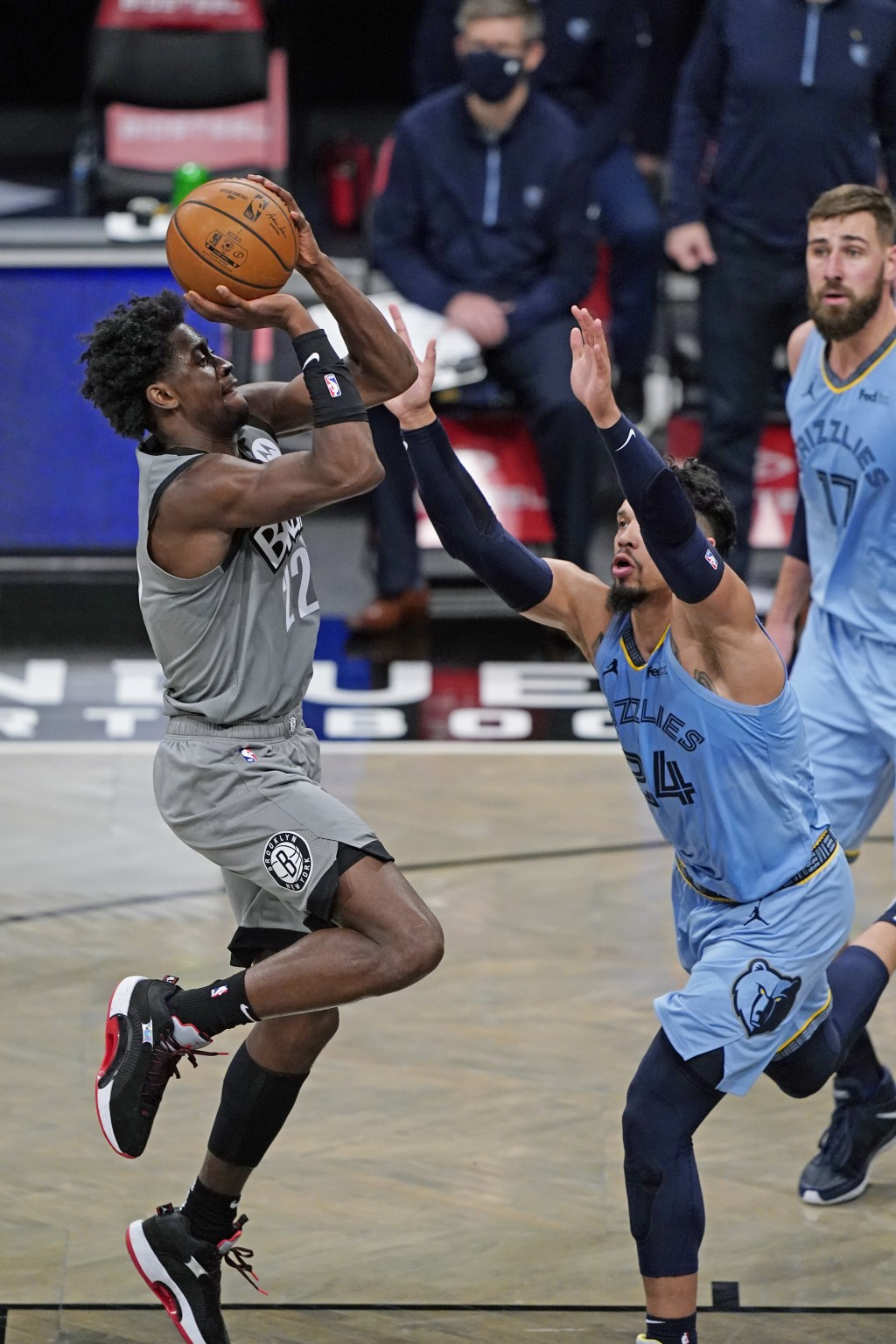 Brooklyn Nets guard Caris LeVert (22) shoots with Memphis Grizzlies guard Dillon Brooks (24) defending during the first half of an NBA basketball game...