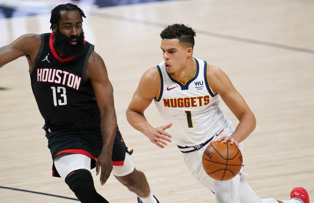 Denver Nuggets forward Michael Porter Jr., right, drives as Houston Rockets guard James Harden defends during the first half of an NBA basketball game...