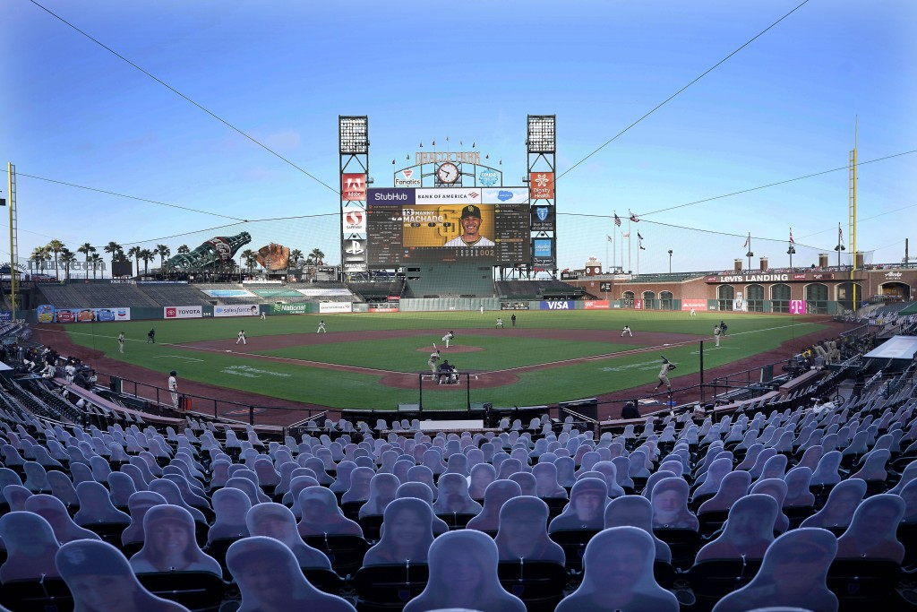 FILE - Cardboard cutouts rest in seats at Oracle Park as the San Francisco Giants play the San Diego Padres during the first inning of a baseball game...