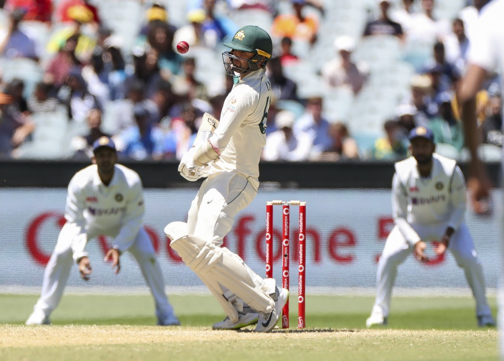 Australia's Nathan Lyon lets a ball pass during play on day four of the second cricket test between India and Australia at the Melbourne Cricket Groun...