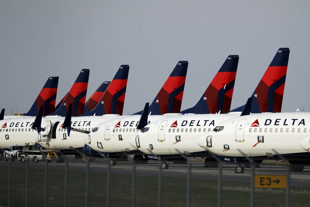 FILE - In this April 1, 2020, file photo, several dozen Delta Air Lines jets are parked at Kansas City International Airport in Kansas City, Mo. A U.S...