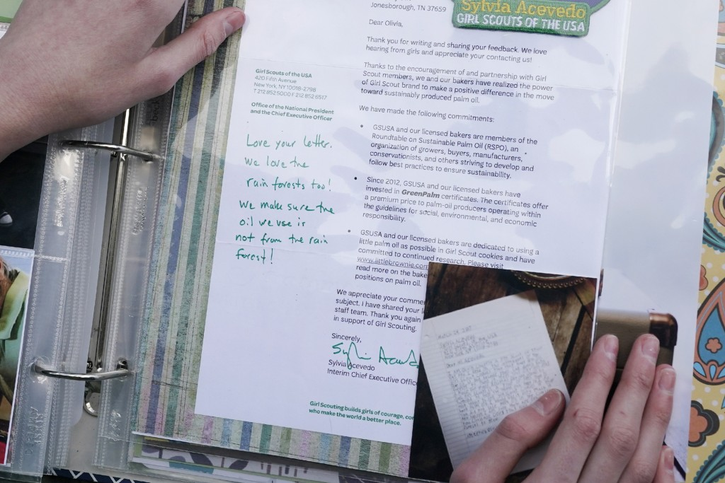 Olivia Chaffin displays a 2017 response she received from the chief executive officer of the Girl Scouts to her concerns with palm oil being used in G...