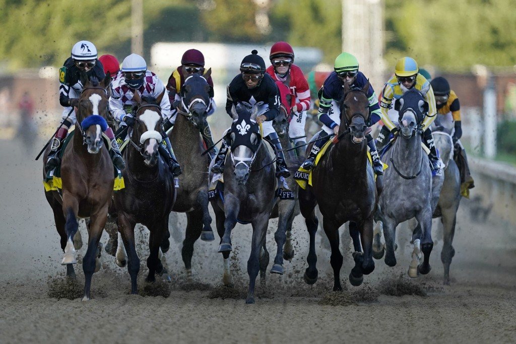 FILE - John Velazquez rides Authentic, left, as they head to turn one in the 146th running of the Kentucky Derby horse race at Churchill Downs in Loui...