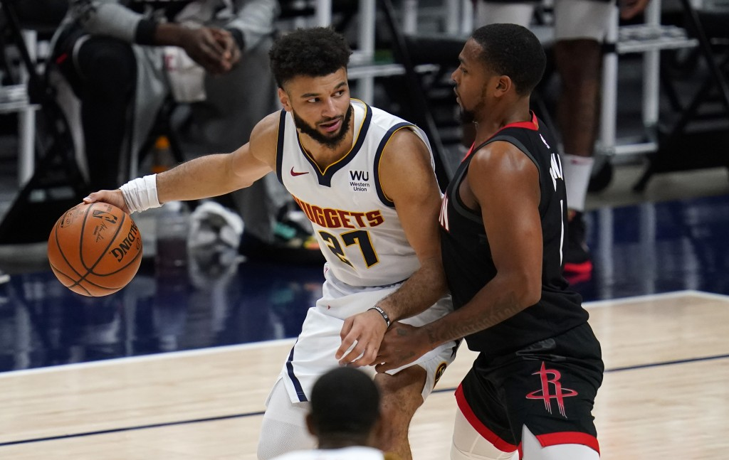 Denver Nuggets guard Jamal Murray, left, looks to pass the ball as Houston Rockets guard Sterling Brown defends during the second half of an NBA baske...