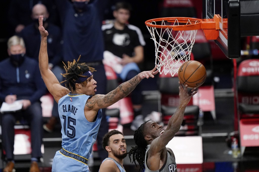 Memphis Grizzlies forward Brandon Clarke (15) defends against Brooklyn Nets forward Taurean Prince, right, during the first half of an NBA basketball ...