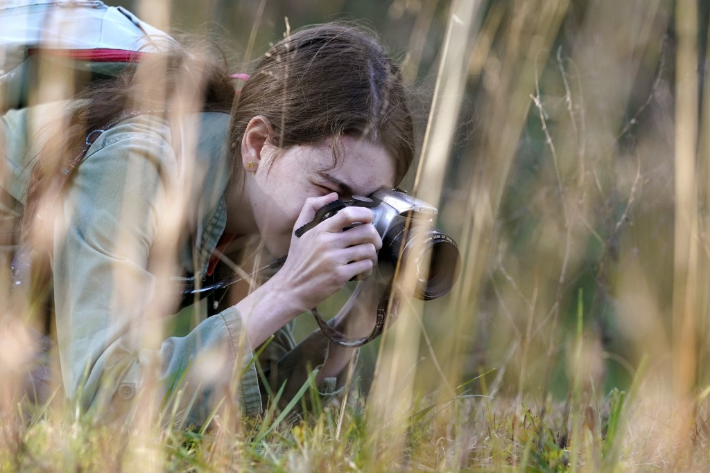 Olivia Chaffin makes photographs in a wooded area as she works on a Girl Scout photography merit badge in Jonesborough, Tenn., on Sunday, Nov. 1, 2020...