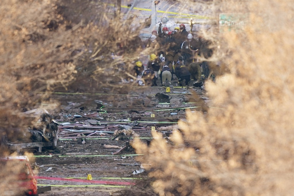 Investigators continue to look through the site of an explosion Monday, Dec. 28, 2020, in Nashville, Tenn. Federal officials now turn to exploring the...