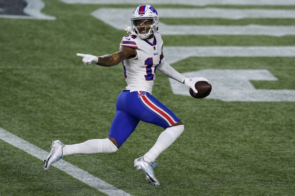 Buffalo Bills wide receiver Stefon Diggs crosses the goal line for a touchdown after catching a pass in the first half of an NFL football game against...
