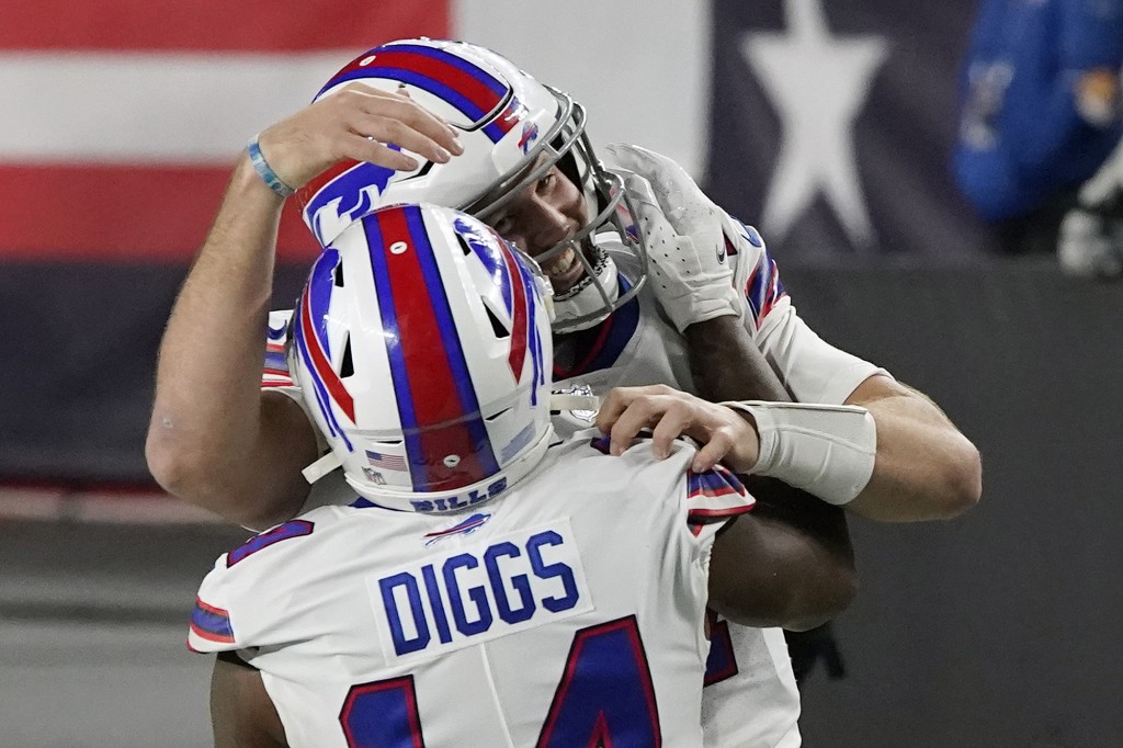 Buffalo Bills quarterback Josh Allen, rear, celebrates his touchdown pass to Stefon Diggs, front, in the first half of an NFL football game against th...