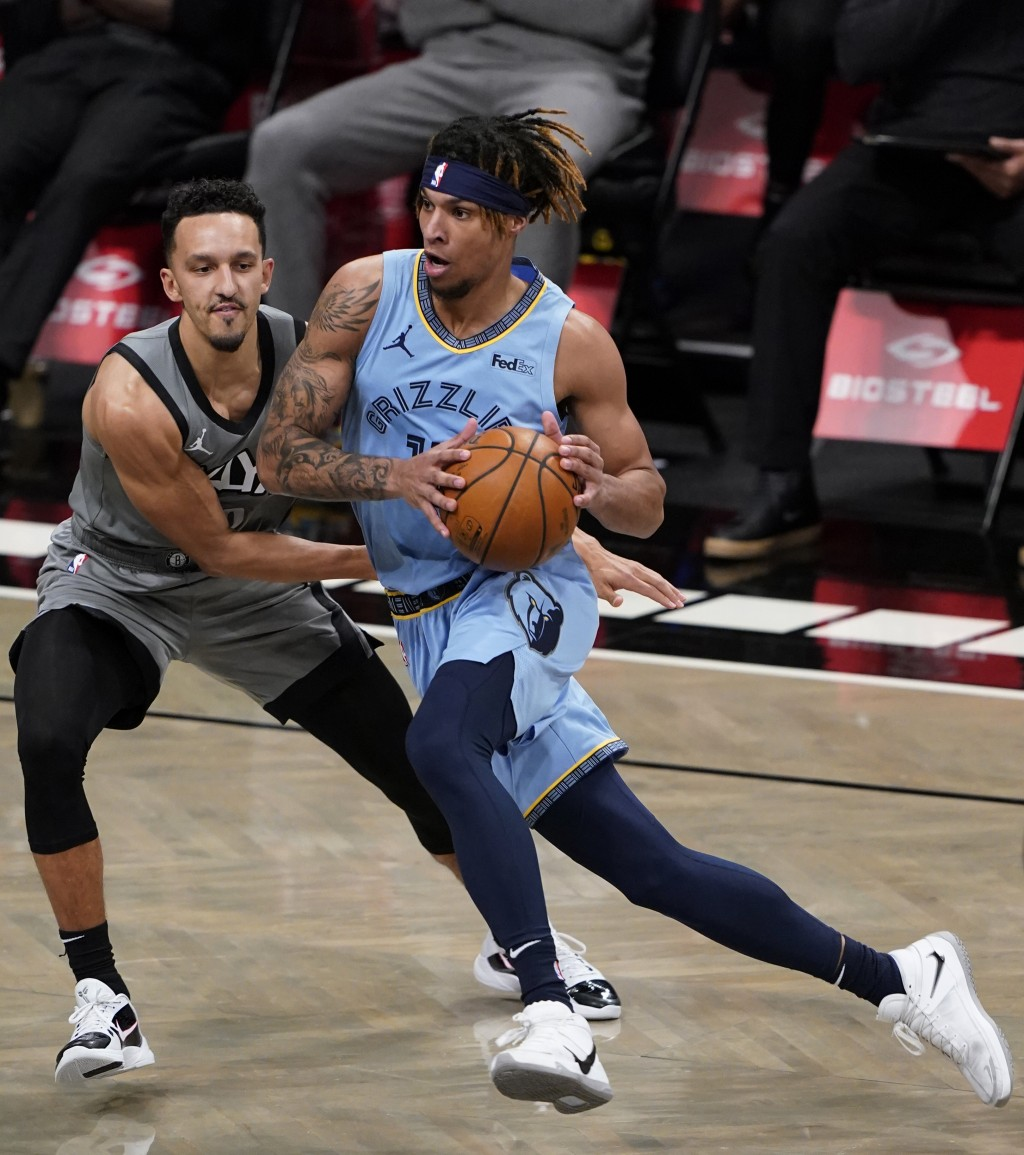 Brooklyn Nets guard Landry Shamet, left, defends against Memphis Grizzlies guard Ja Morant during the first half of an NBA basketball game Monday, Dec...