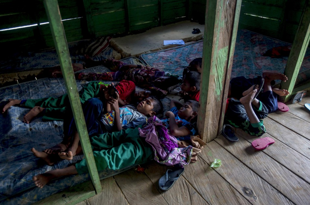 Students of a boarding school rest in their dormitory in North Kalimantan, Indonesia, on Tuesday, April 9, 2019. Some palm oil workers who work illega...