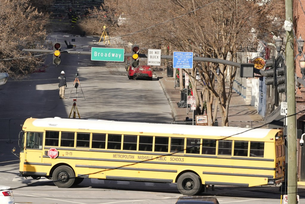 A parked school bus blocks the public's view of the damage caused in a Christmas Day explosion Monday, Dec. 28, 2020, in downtown Nashville, Tenn. Fed...
