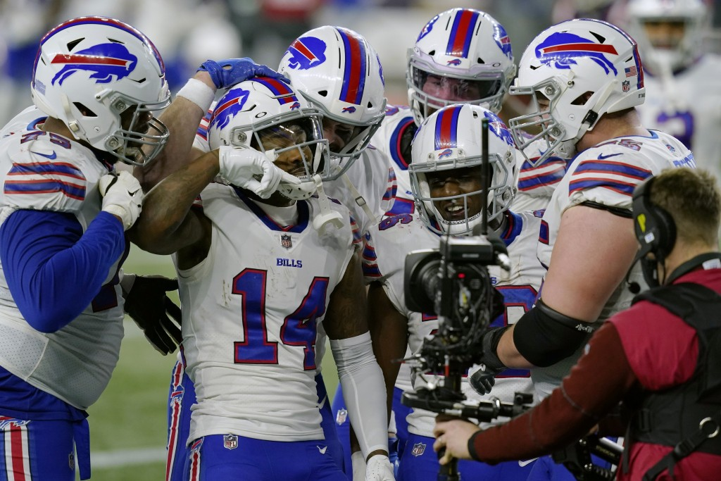 Buffalo Bills wide receiver Stefon Diggs (14) celebrates his touchdown with teammates in the second half of an NFL football game against the New Engla...