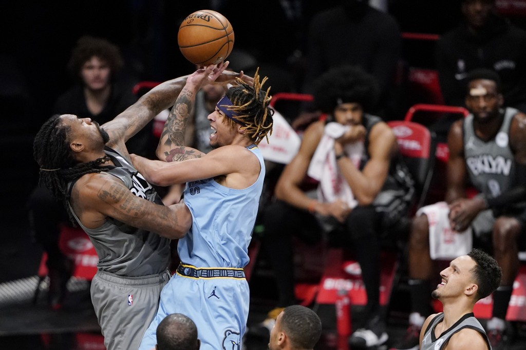 Brooklyn Nets center DeAndre Jordan, left, defends against a shot by Memphis Grizzlies forward Brandon Clarke during the first half of an NBA basketba...