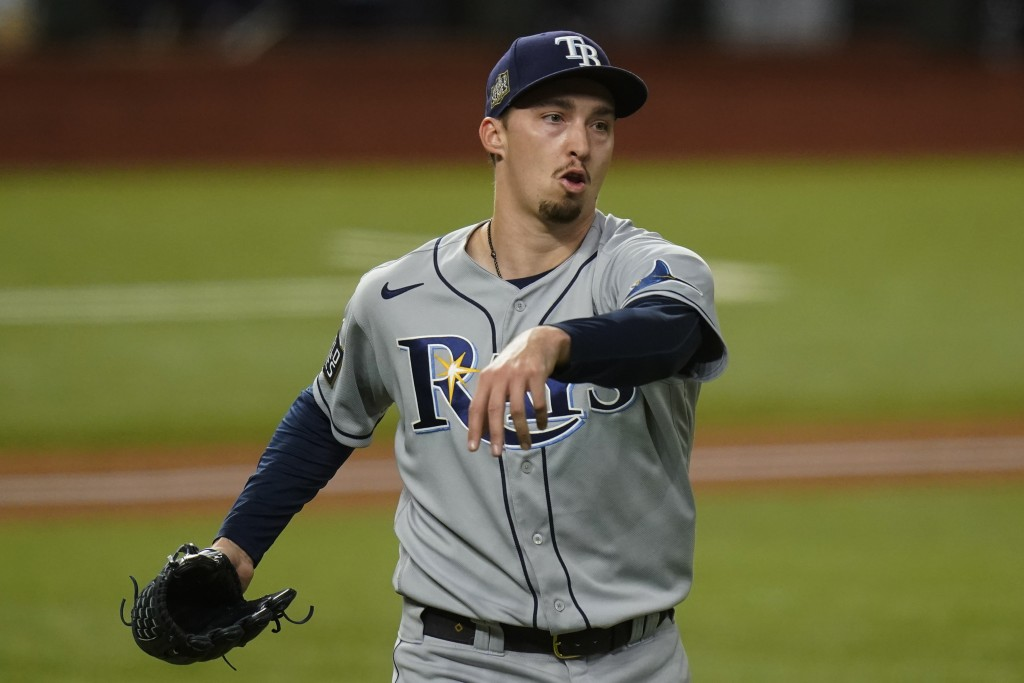 FILE - Tampa Bay Rays starting pitcher Blake Snell celebrates the end of the fifth inning against the Los Angeles Dodgers in Game 6 of the baseball Wo...